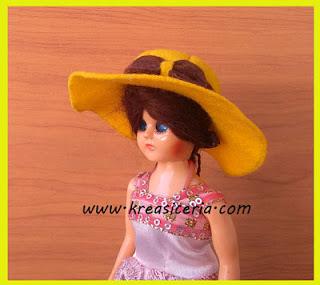Topi boneka dari bahan kain flanel