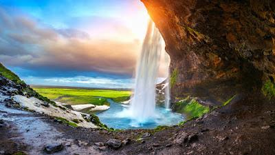 Seljalandsfoss waterfall at sunset