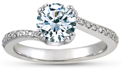 A round brilliant cut diamond in an 18K white gold Seacrest engagement ring setting with diamond accents