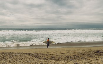 Wallpaper: Surfer, Sandy Beach and Ocean Waves