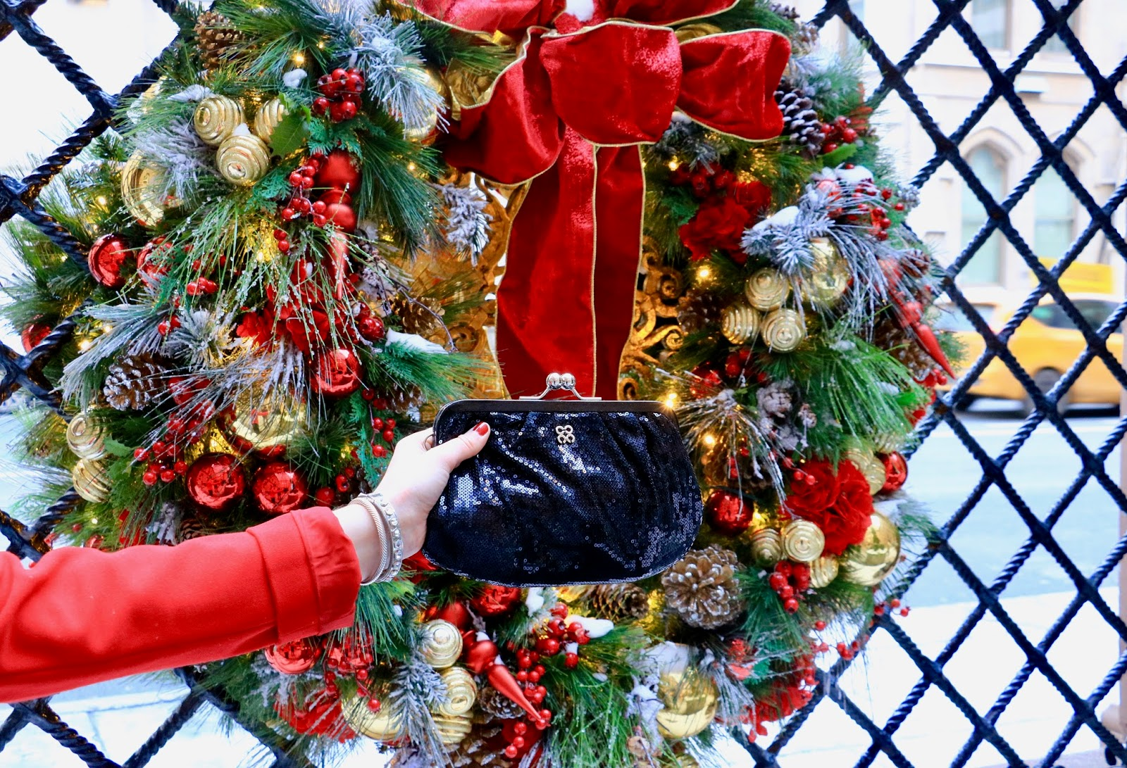 Nyc fashion blogger Kathleen Harper with a sparkly black clutch by Coach