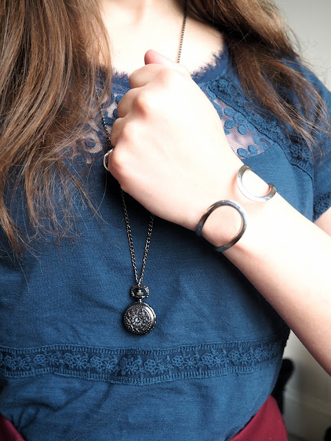 Just a Kid from Brooklyn | Captain America Marvel/ Disneybound outfit jewellery details of black pocket watch pendant necklace & silver bangle, with dark blue top