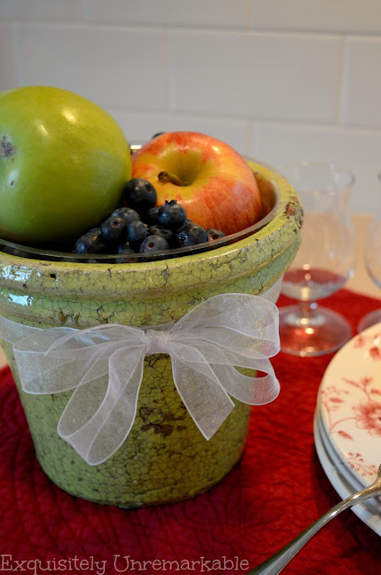 Green flower pot with fruit inside
