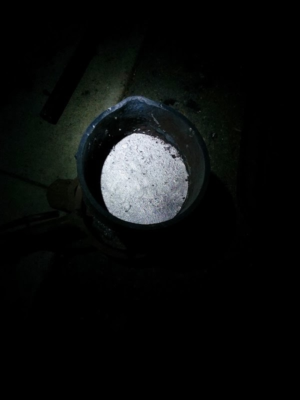 aluminum solidified in crucible