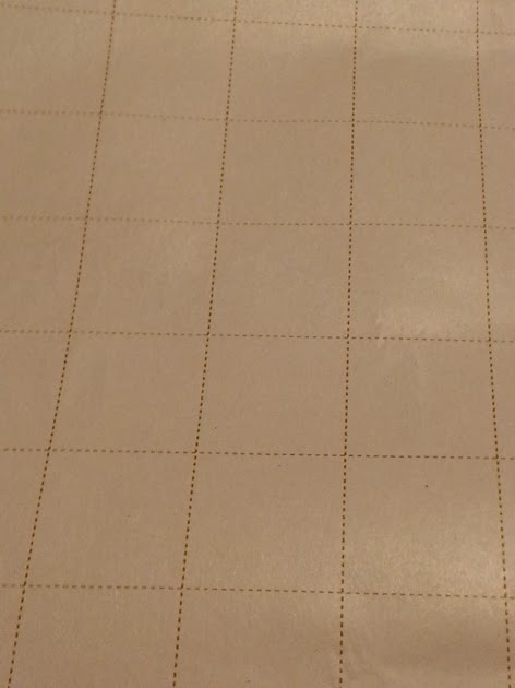Grid Lines on the back of wrapping paper makes it easy to use for a bulletin board.