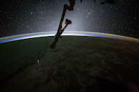 Earth and Dragon Spacecraft seen from the International Space Station