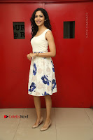 Actress Ritu Varma Stills in White Floral Short Dress at Kesava Movie Success Meet .COM 0020.JPG