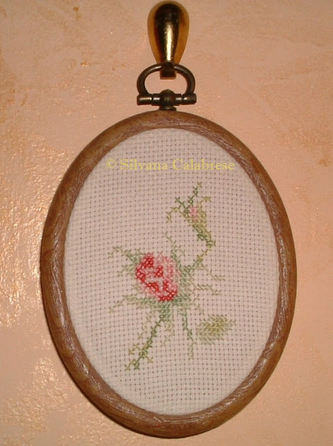 Rose embroidered cross-stitch in small oval painting Loving San Francisco