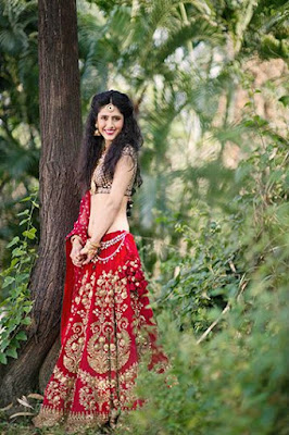 Sabyasachi Stunning Red Bridal Wedding Lehenga With Golden Zardozi Embroidery.