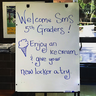 This image shows a easel welcoming incoming 5th graders during the summer ice cream social.