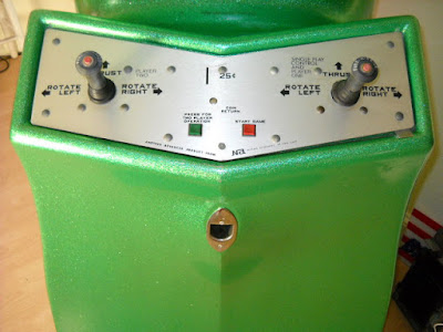1972 Green with speckle-fleck glitter cabinet and brushed stainless steel shallow-V control panel with two joysticks, two buttons, coin slot and instructions.