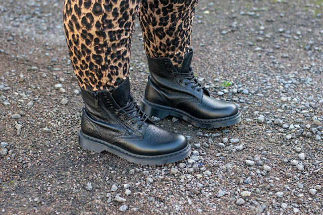 Close up of black Dr Martens boots