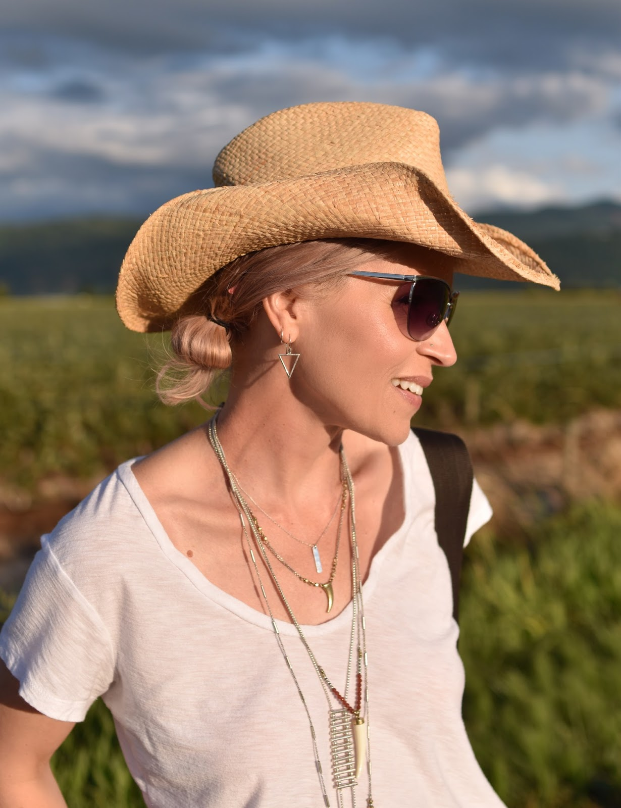 Monika Faulkner outfit inspiration - slouchy white tee, wire-frame sunglasses, cowboy hat, layered Lucky Brand necklaces