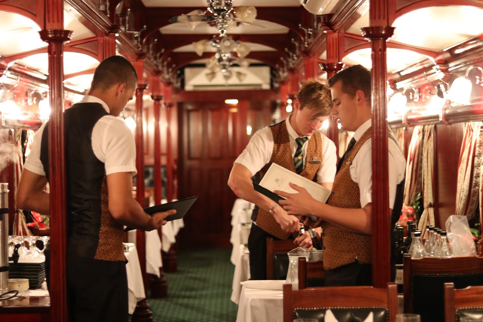 Waiters aboard Rovos Rail, dining carriage