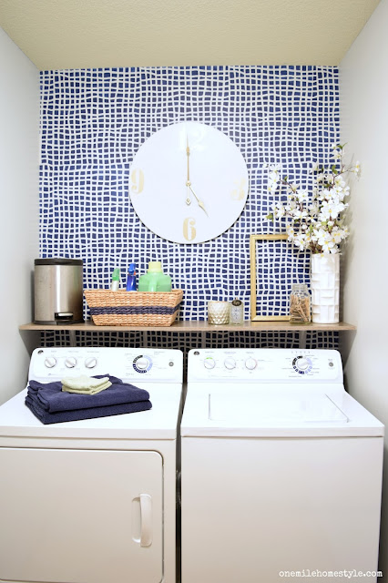 Add a bold accent wall to a tiny laundry room to give it a brand new look!