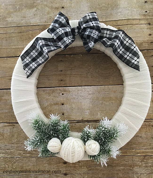 Vintage Paint and more... a winter wreath made by wrapping cream colored yarn around a styrofoam wreath form and embellishing with winter items