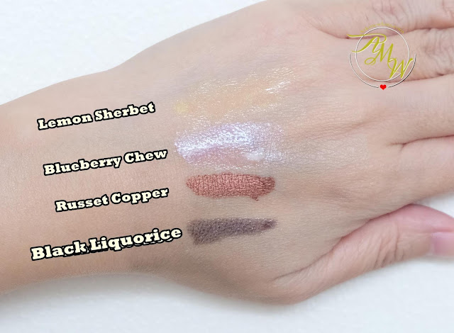 a photo of The Body Shop Shine Lip Liquid lipsticks Review in shades Lemon Sherbet, Blueberry Chew, Russet Copper and Black Liquorice by Nikki Tiu of www.askmewhats.com