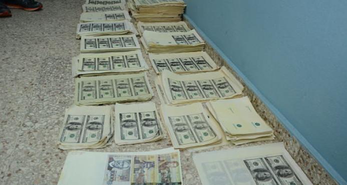Ocupan más de cinco millones de dólares falsos durante allanamiento en residencia de Santo Domingo Este