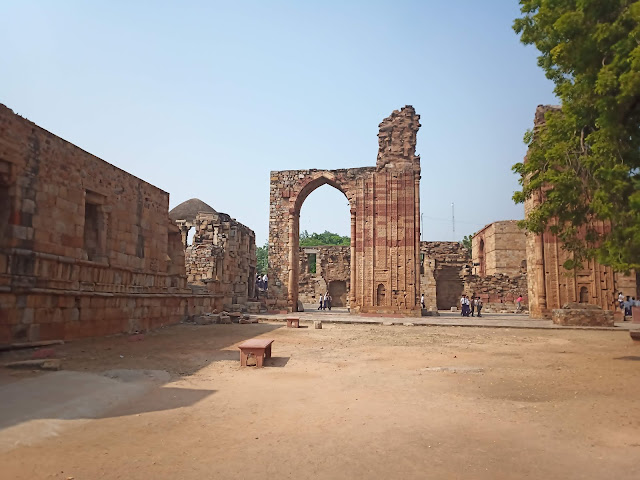 View of walls and stone architectural remains in Qutub complex, Delhi