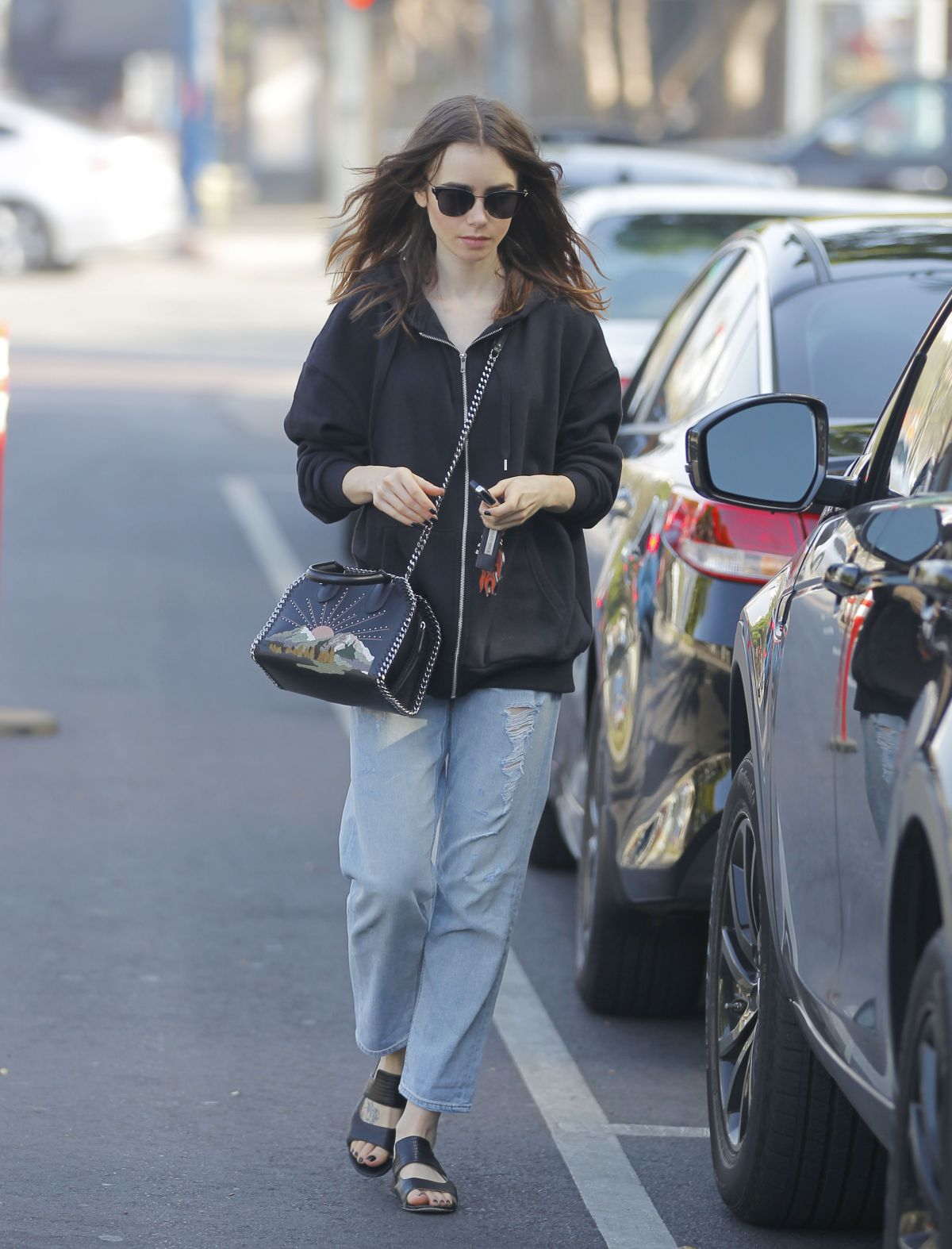 Photos of Lily Collins leaves her car in Beverly Hills