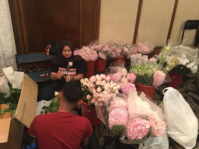 getting flowers ready for wedding
