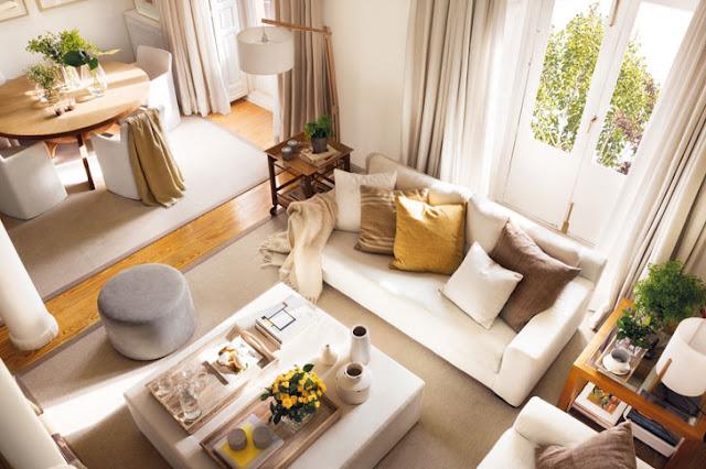Tonuri naturale de culoare și o atmosferă de vis într-un apartament pe două niveluri din Spania