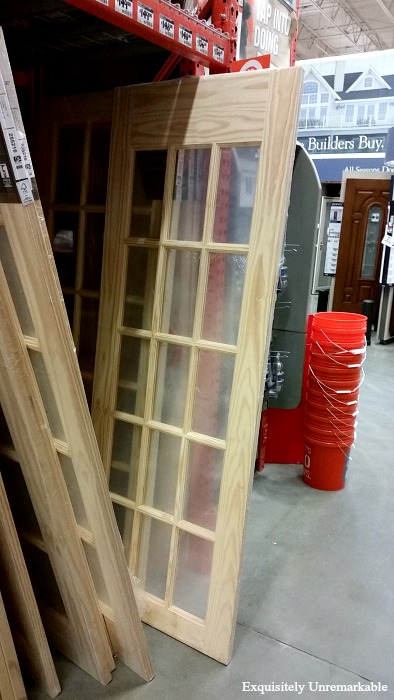 Jeld Wen French Glass Paned Interior Wooden Door on floor at Home Depot