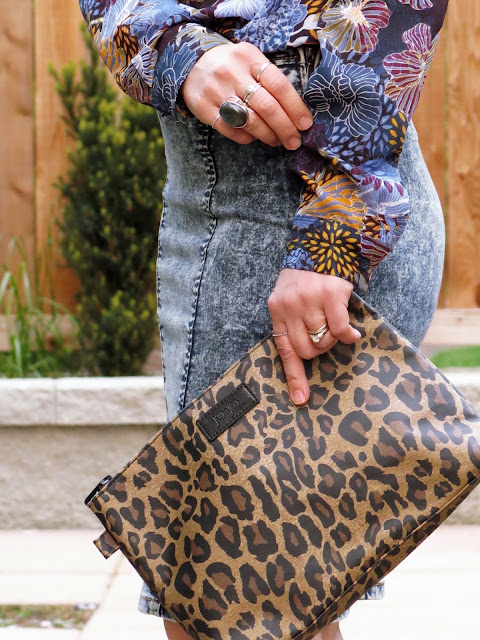 floral blouse, acid-washed denim skirt, leopard-print clutch
