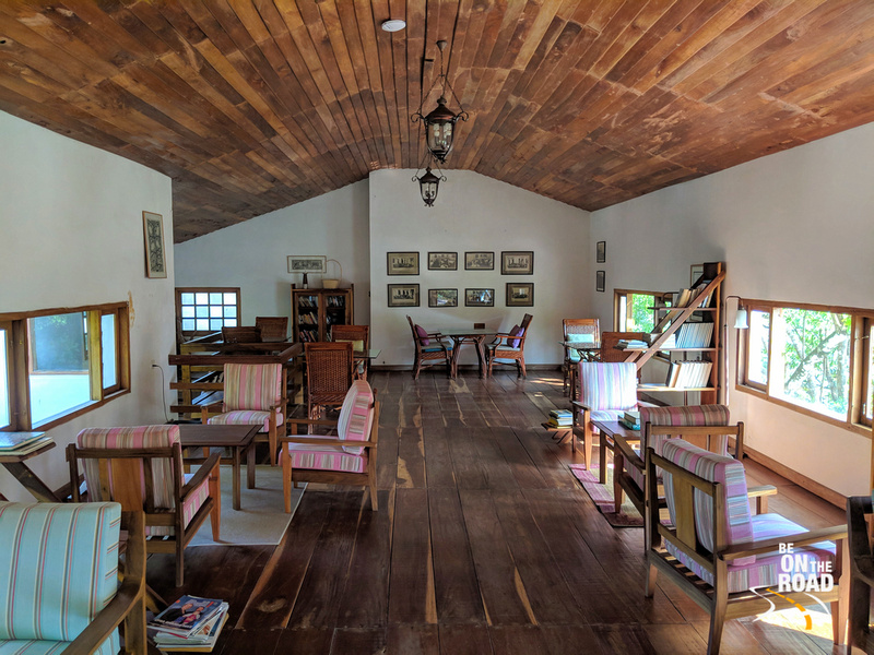 The warm interiors of the library at Windermere Estate, Munnar