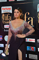 Hansika Motwani in Glittering Deep Neck Transparent Leg Split Purple Gown at IIFA Utsavam Awards 011.JPG