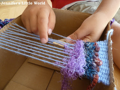 Weaving with children on a cardboard box loom