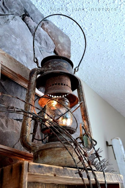 Old rusty lantern lit / part of How to decorate a junk style mantel via https://www.funkyjunkinteriors.net