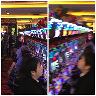 A picture showing a line of Japanese playing pachinko in a blur of flashing lights and smoke