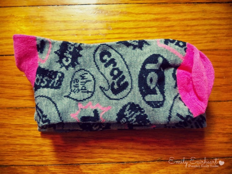 Pink and grey knee socks with words on them