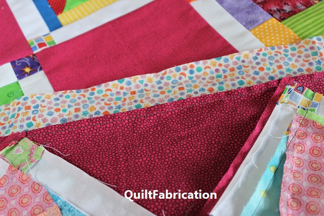 front and back of pink fabric in Crumb Jumble Pink quilt