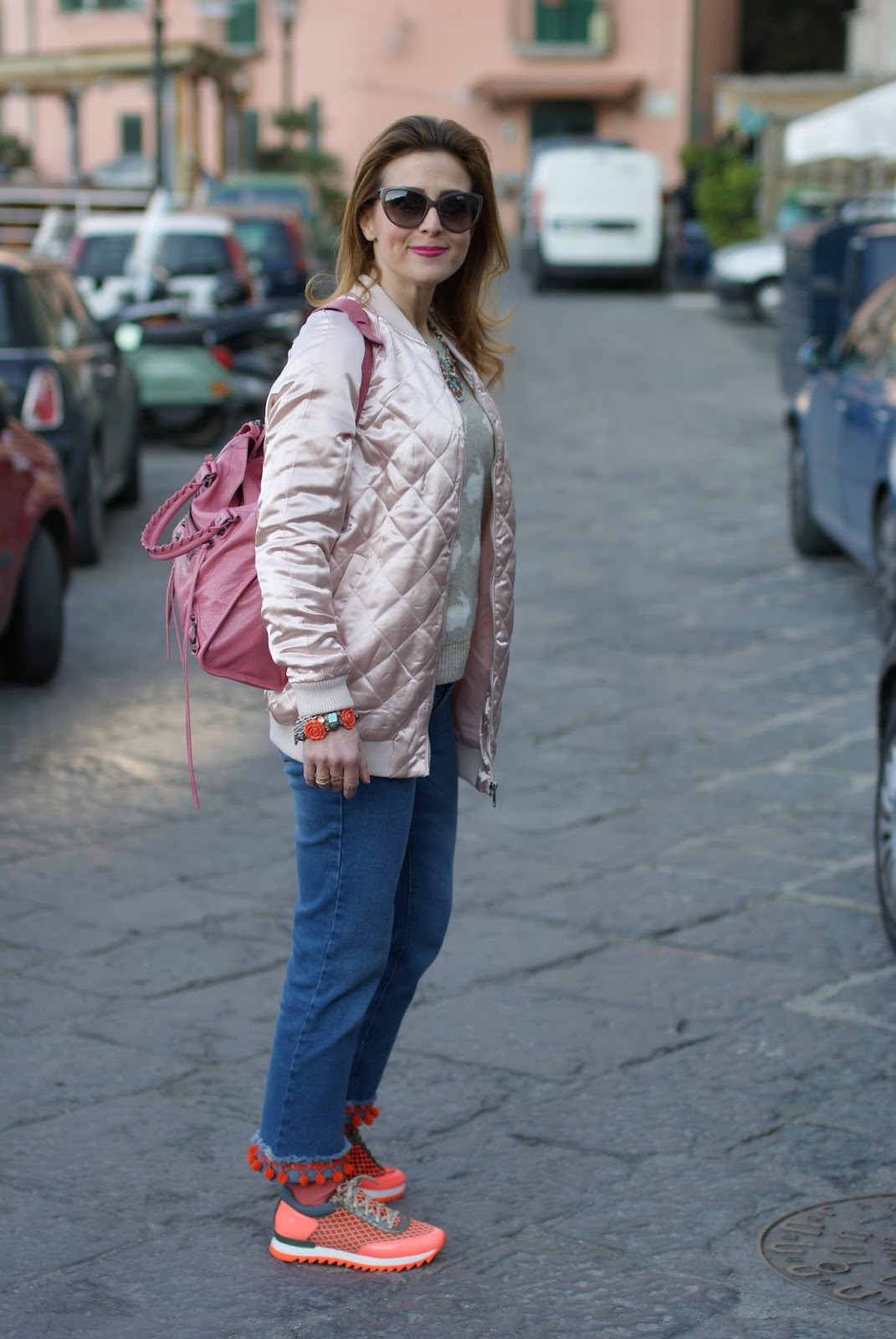 Pink satin bomber jacket, uno8uno sneakers, custom Dondup lookalike jeans in Sorrento coast on Fashion and Cookies fashion blog, fashion blogger style