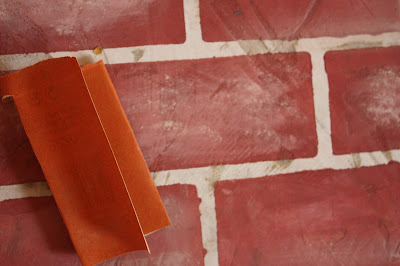 sandpaper and concrete with painted brick pattern