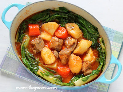 Adding bananas into this melt-in-your-mouth tender beef or pork stew brings so much flavor and richness to this Asian classic.  This Filipino stew is a huge family favorite and a dish you'll make over and over again! #pochero #filipinofood #asiancuisine #pork #beef