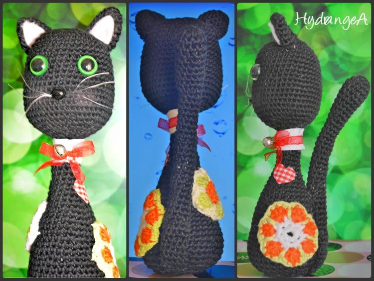 Amigurumi gatito negro con parches de colores