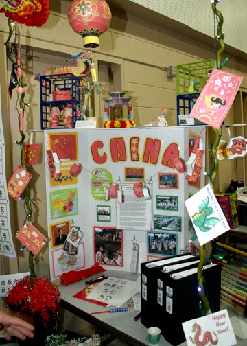China's booth featured some super cute decor. They handed out chopsticks, lucky red Chinese New Year envelopes and fortune cookies along with their SWAPs. Tessa especially enjoyed this booth because we had just studied Medieval China earlier in the week and she had been playing Chinese New Year for weeks.
