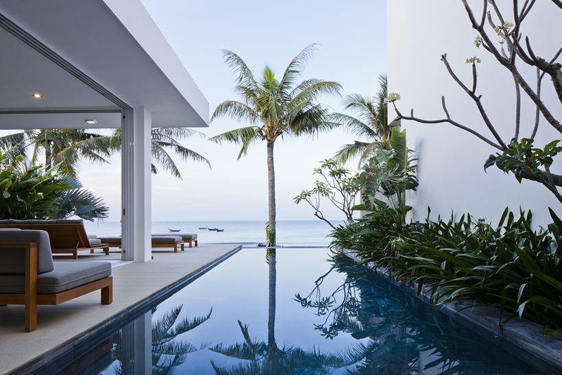 Swimming pool view and ocean in modern beach house