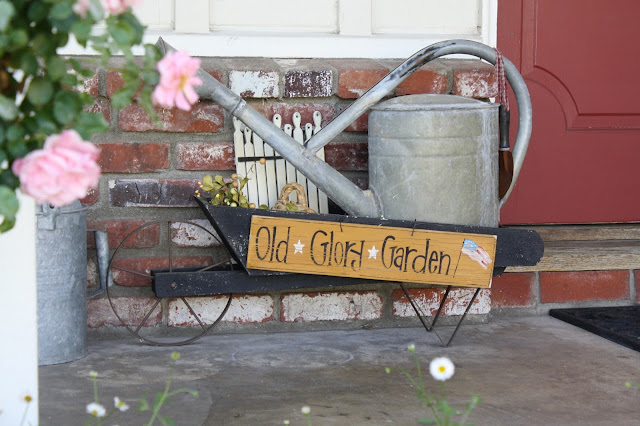 decorate front porch, watering cans, wheelbarrow