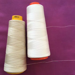 cones of Aurifil Forty3 and 50 weight thread