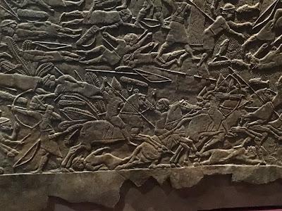 Assyrian stone frieze showing battle scene