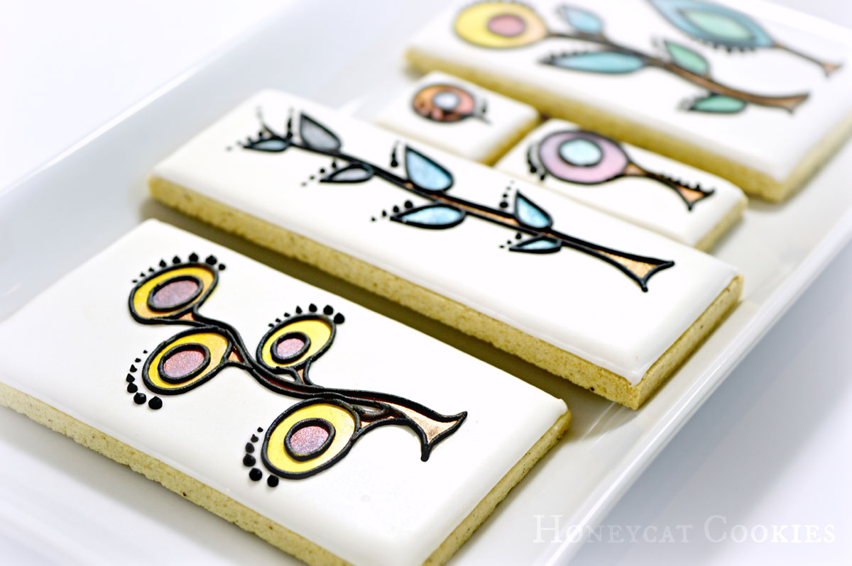 Cookies decorated with stylised plants and lustre dust, by Honeycat Cookies