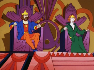 A still image of He-Man's mom and dad sitting on thrones in the throne room.