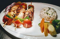 Easy Hawaiian chicken kebabs kabobs recipe with parsley butter rice and sauteed vegetables
