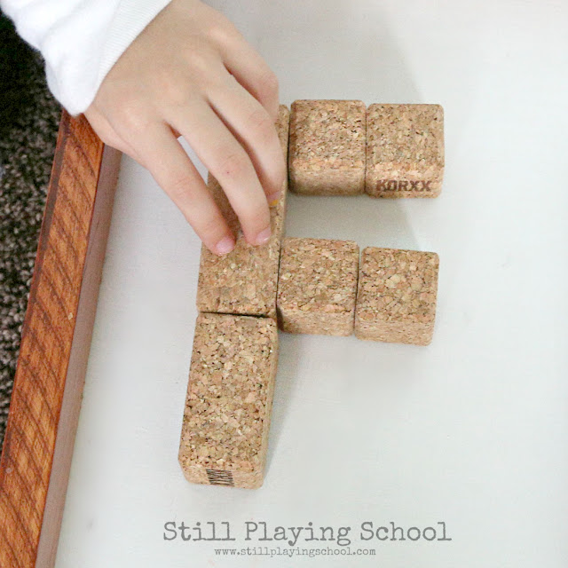 This literacy center invites kids to build letters with KORXX cork building blocks