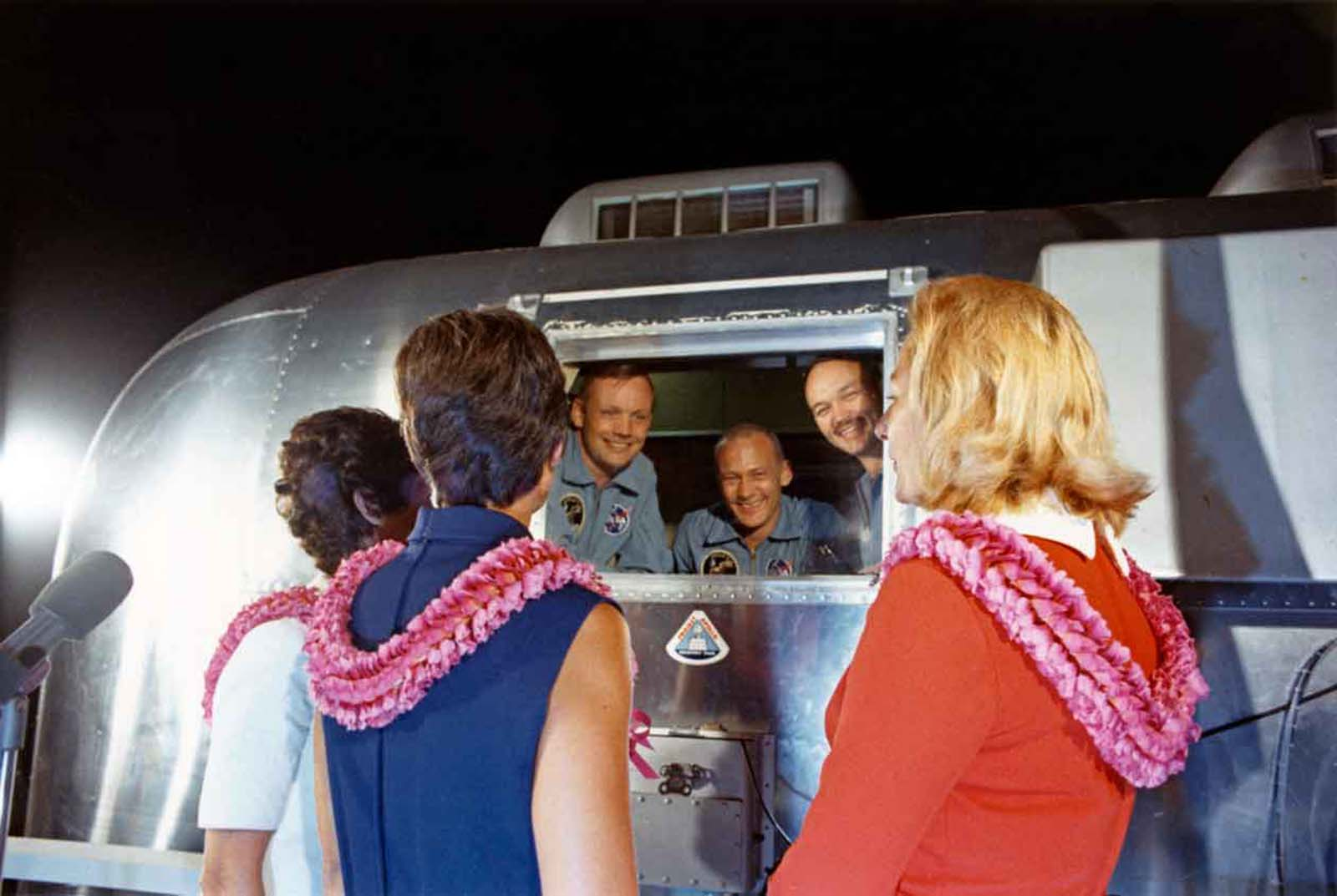 The three crew members of NASA's Apollo 11 lunar landing mission are greeted by their wives after their arrival at Ellington Air Force Base near Houston in Texas in a Mobile Quarantine Facility (MQF) earlier that day, 27th July 1969. From left to right, astronauts Neil A Armstrong, Edwin E 'Buzz' Aldrin Jr and Michael Collins and their wives (left to right) Pat Collins, Jan Armstrong and Joan Aldrin. The crew remained in the MQF until they arrived at the Crew Reception Area of the Lunar Receiving Laboratory (LRL) at the Manned Spacecraft Center (MSC). They will be released from quarantine on 11th August