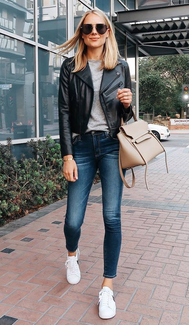 comfy fall outfit idea to try right now / sneakers + nude bag + skinnies + moto jacket + grey top